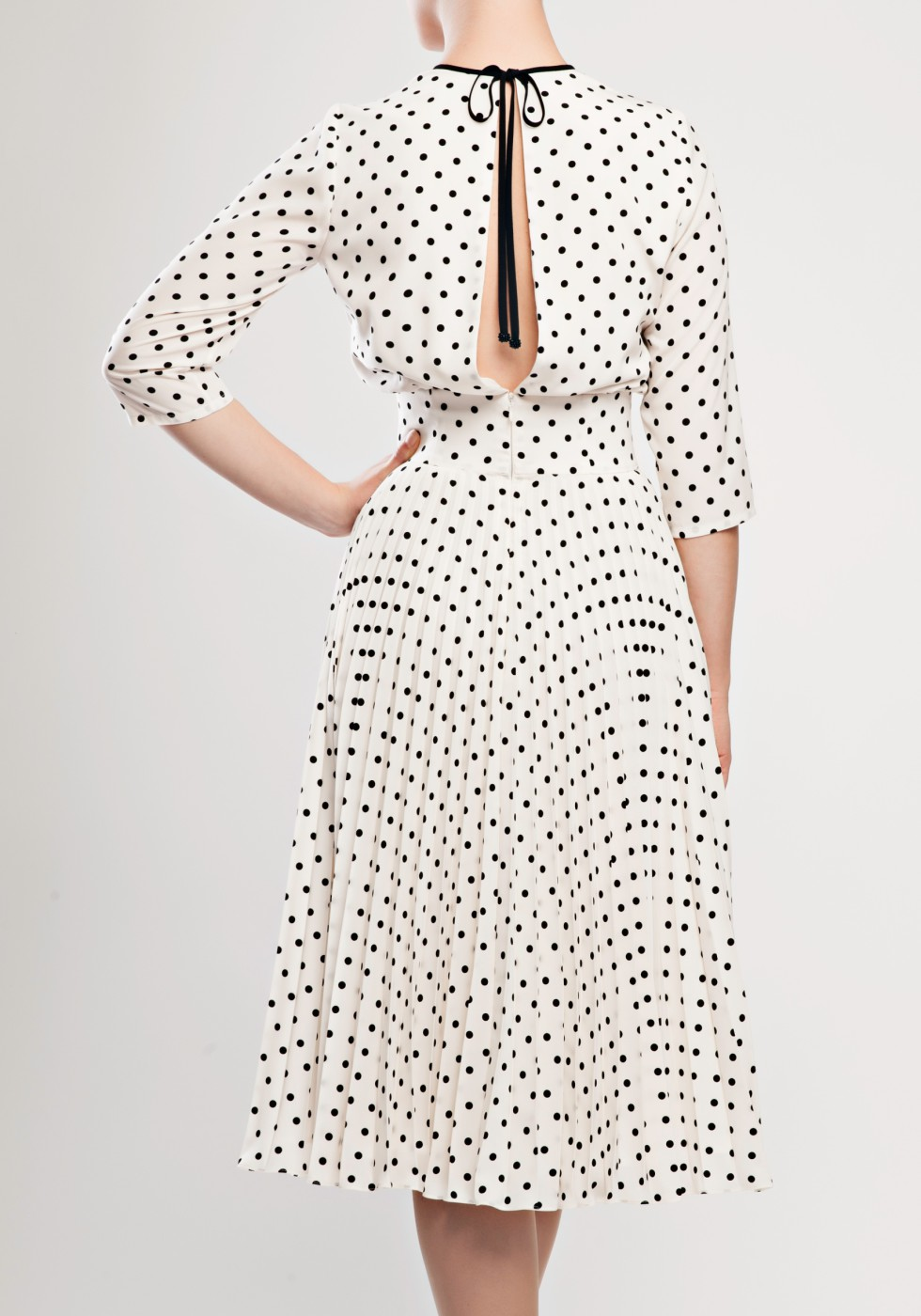 Slit-back pleated polka-dot dress