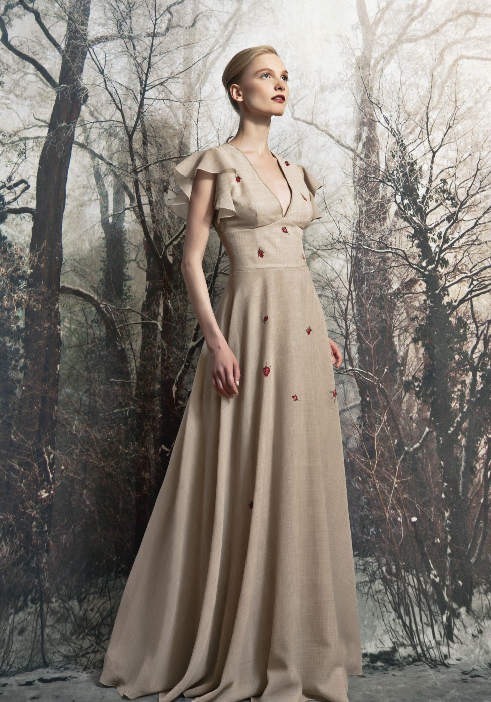 V-neck woolen gown with hand-embroidered roses
