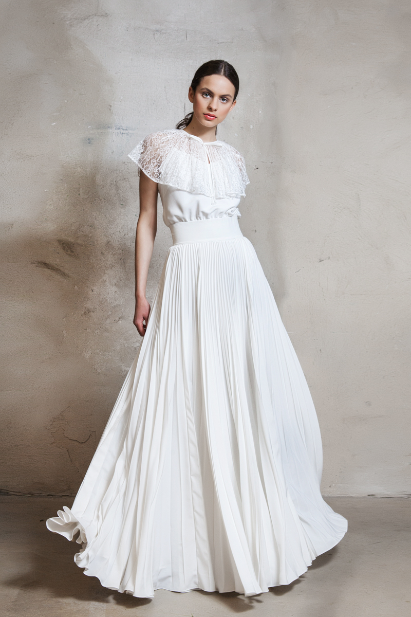 Sun-ray pleated gown with lace capelet